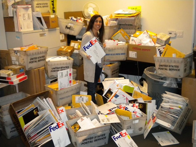 Early days: Lynne sorting through the thousands of audition tapes which arrived by Fedex.